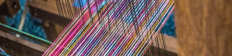 colorful threads of a loom