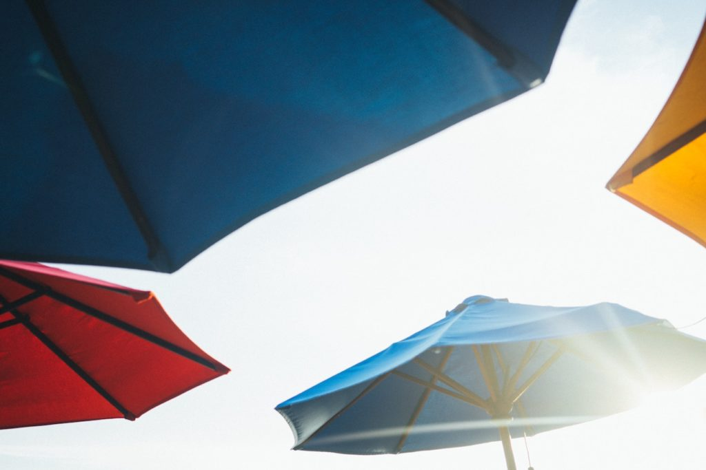 a number of colorful beach umbrellas