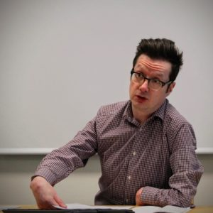 Photograph of Jonathan Paul Mitchell speaking at a workshop