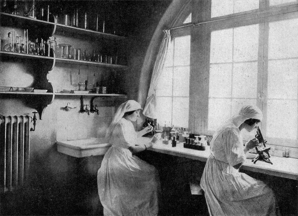 Two women conducting scientific research in a lab