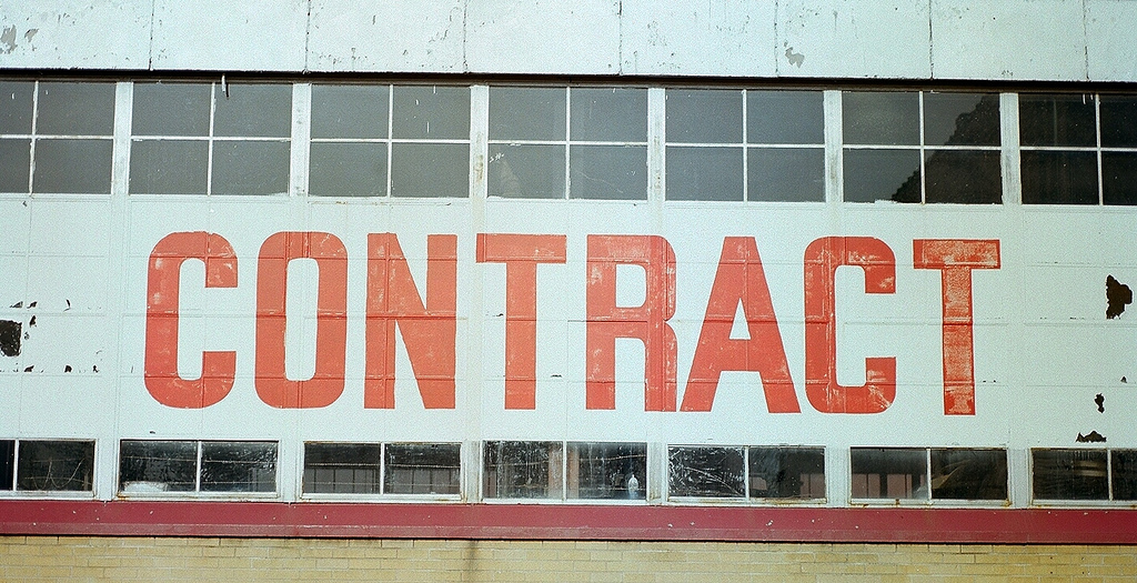 Building with the word 'contract' written on it in large red capital letters