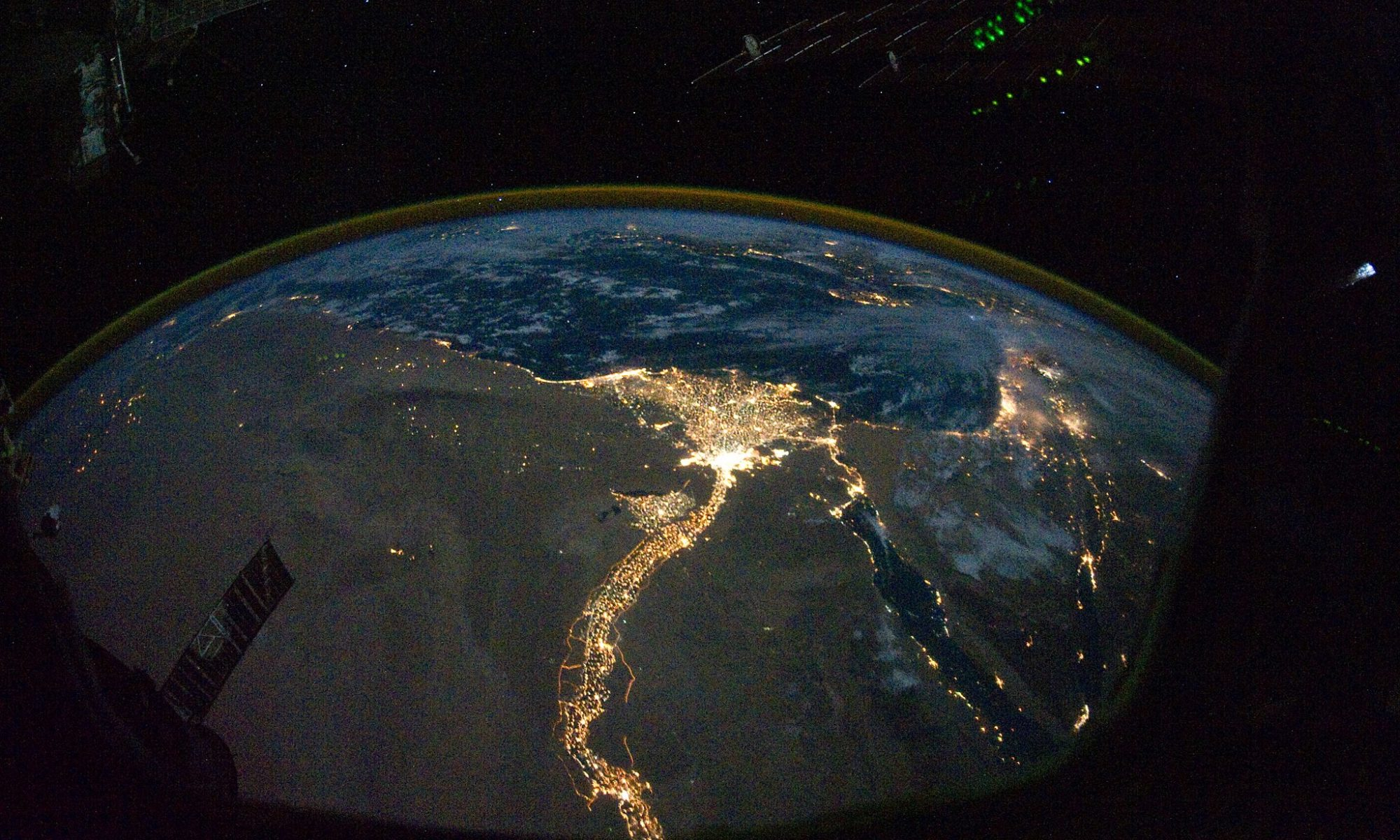 Satelite image of the Eart at night, showing the Nile illuminated by the electric light of cities and roads