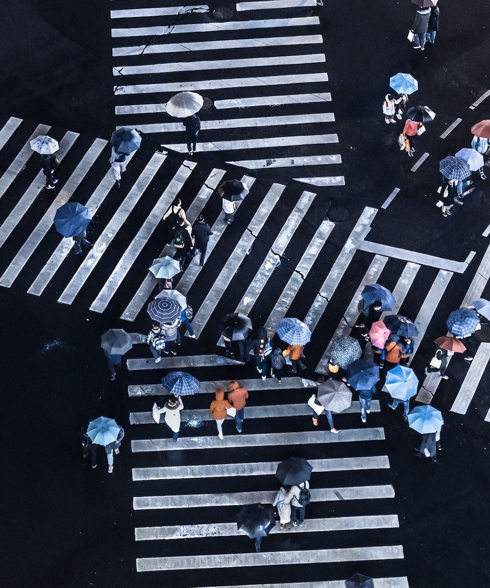 intersecting pedestrian crossings with people walking