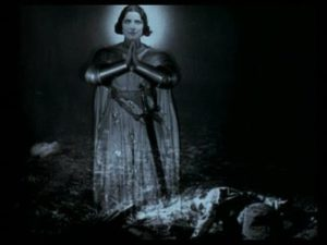 The shot of Joan's floating apparition, sanctifying Trent's sacrifice, represents the implied ambiguity of the action.