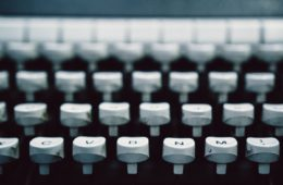 profile view of a typing keyboard