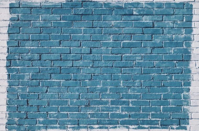 blue painted brick wall