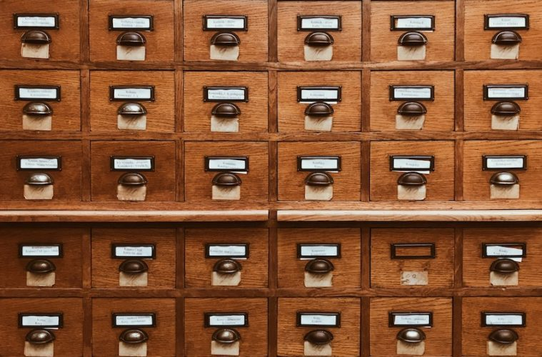 wooden card catalog drawers
