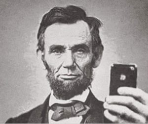 Doctored image of Lincoln holding a smartphone