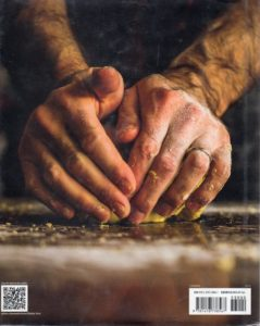Hands kneading dough - back cover of The Tucci Table : cooking with family and friends