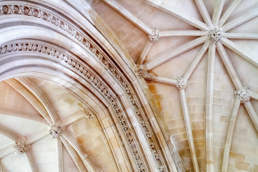 photograph of a decorative, vaulted ceiling