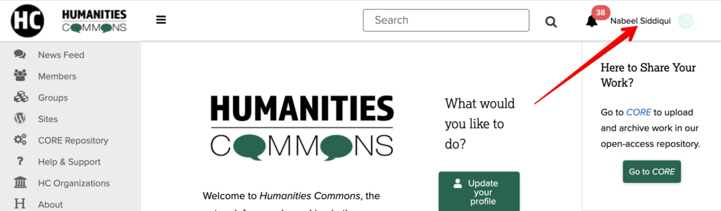 Image displays main page of Humanities Commons with an arrow pointing in the top right to the name of the logged in user.